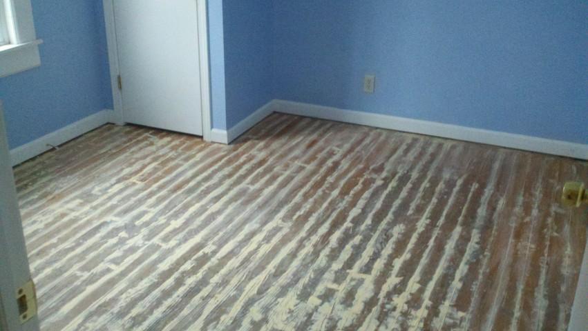 scuffed up hardwood floor