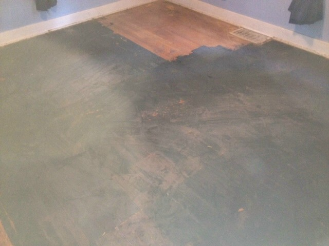 hardwood floor with black paint stains
