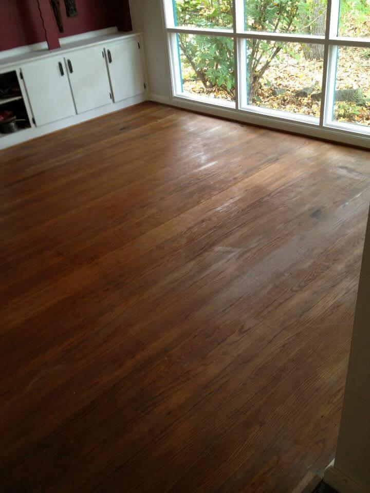 a severely damaged hardwood floor