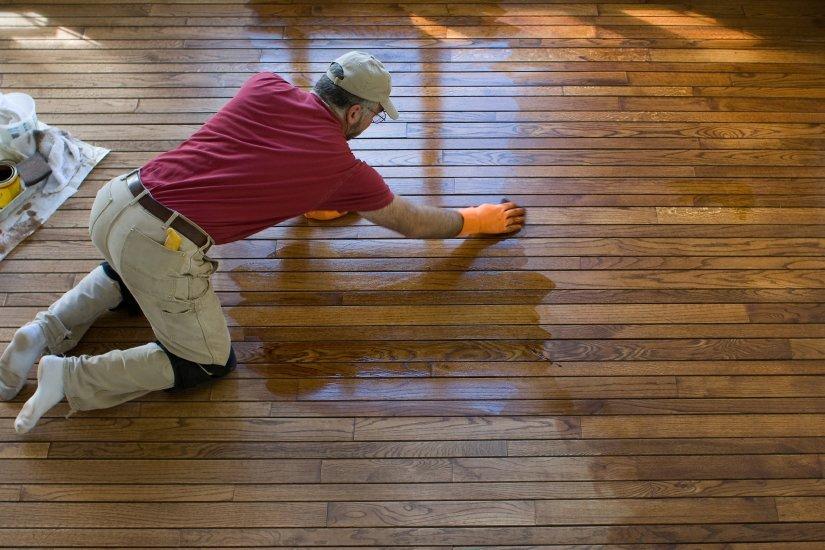 A dublin wood floor refinisher hard at work on a wood floor